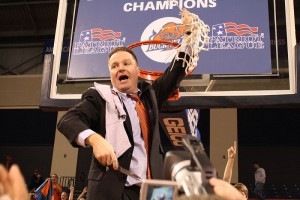 Dave Paulsen cuts down the net after he led his team to a Patriot League Championship in his third year of coaching the Bison