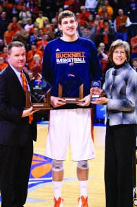 Mike Muscala '13 poses with head coach Dave Paulsen and Patriot League Executive Director Carolyn Schile Femovich.